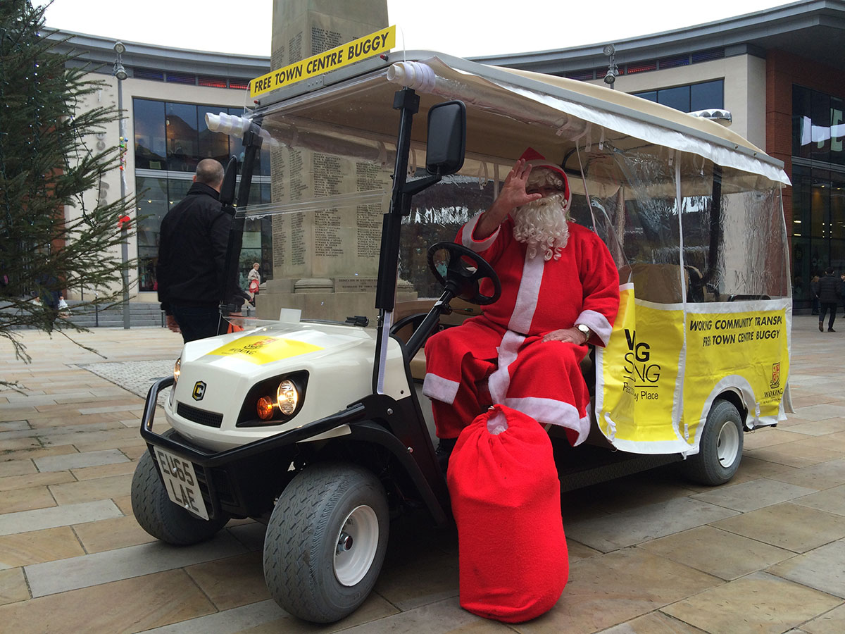 Santas Christmas greeting from a Town Buggy