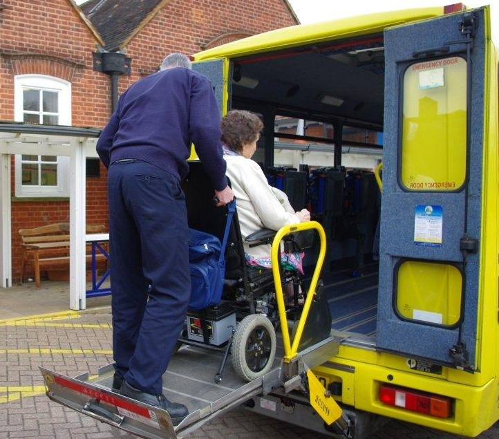 WokingBustler operating the disability passenger lift